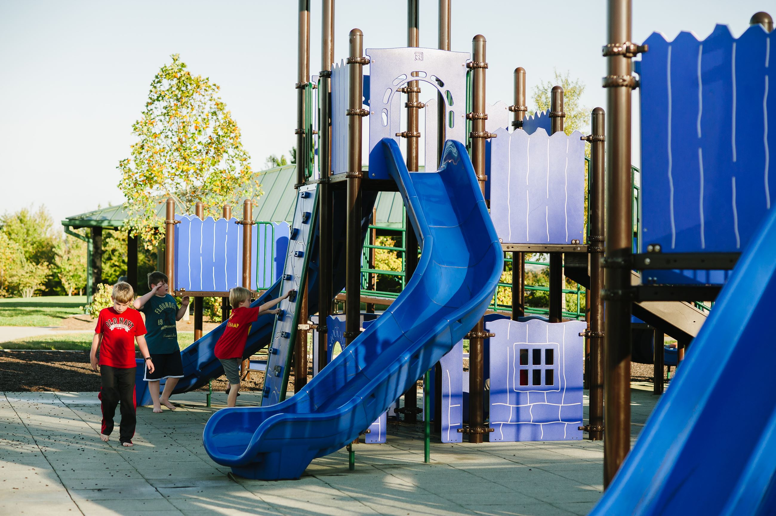 A photo of children playing on the McFee Park playground.