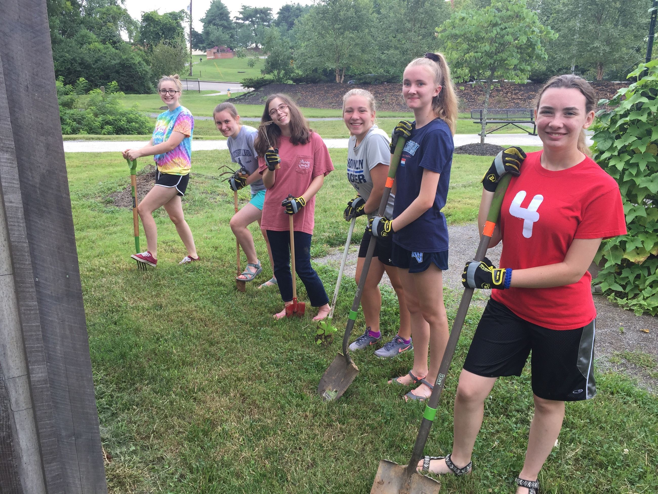 group of young girls with shovels
